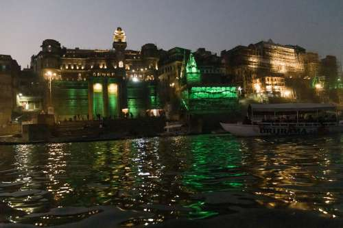 Green City Lights Reflecting On Water Photo