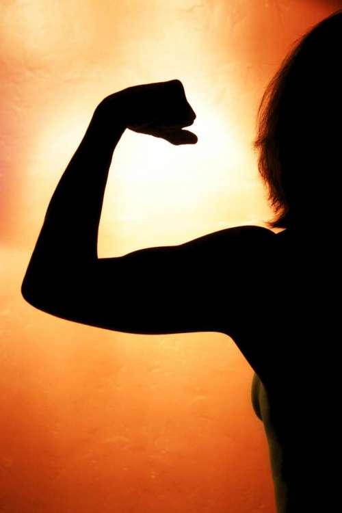 Healthy Woman Flexes Muscles