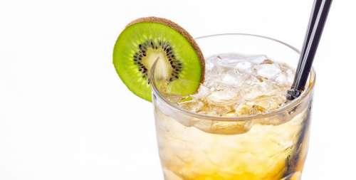 Close up of a glass of cocktail with Kiwi fruit