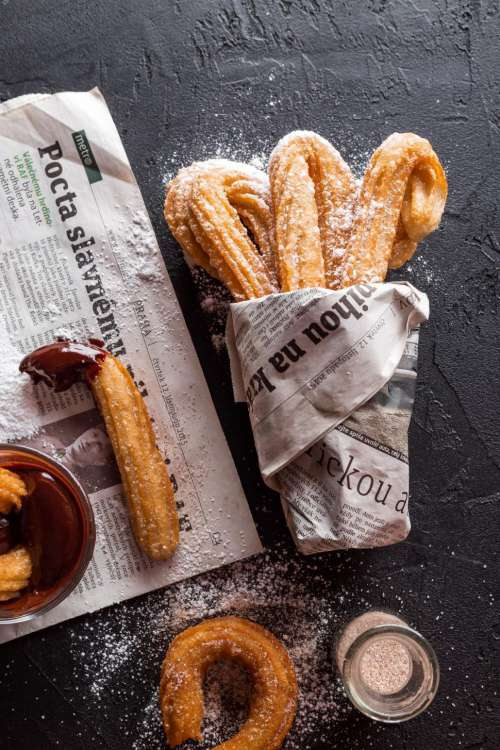 Freshly Baked Churros with glass of coffee