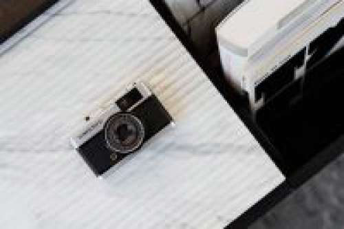 Old camera on marble