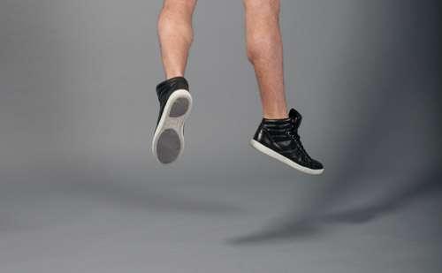 Mens Fashion Kicks Jumping On Grey Background