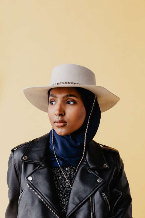Woman In Cowboy Hat And Leather Jacket Photo