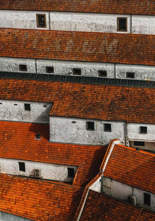 Red  Roofs And White Walls Photo