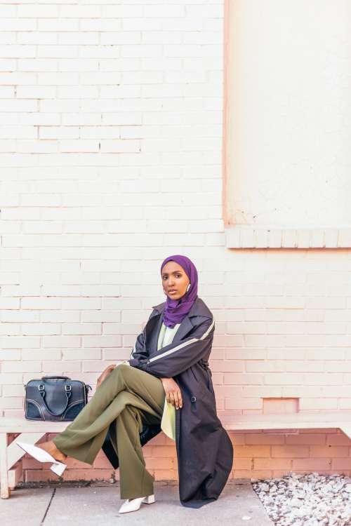 Woman Waits On Bench Photo
