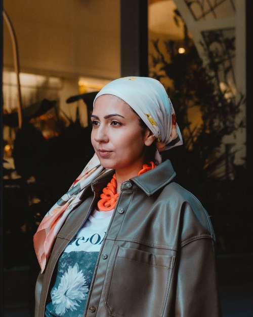 Fashionably Dressed Woman In Headscarf Photo