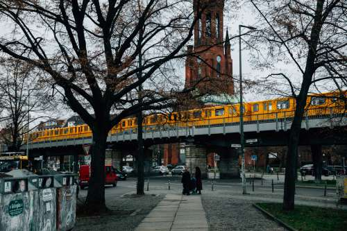 Yellow Subway Train Over Downtown Photo