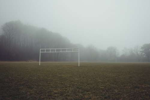 Eerie View Of A Foggy Soccer Field Photo