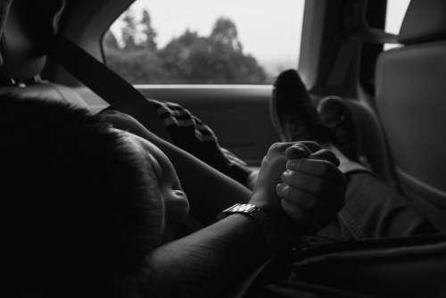 Young Boy Naps During Car Ride Photo