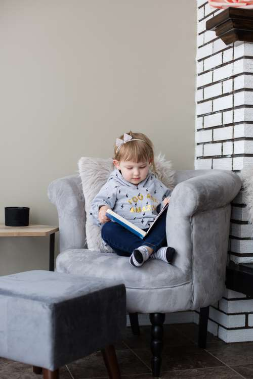 Cuddled Up In A Big Chair With A Good Book Photo