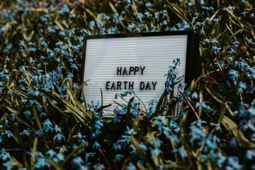 Happy Earth Day Sign In Flowers Photo