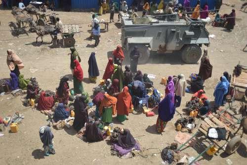 people, crowd, women, military vehicle, patrol, natives, pedestrians, crisis