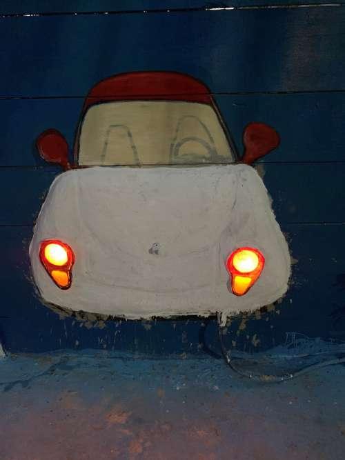 cartoon car, painted wall, headlight, artistic, DIY, handmade