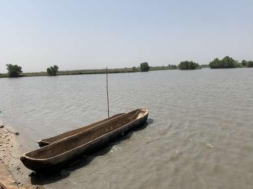 water, lake, river, canoe, boat, travel, rowboat, watercraft, seashore, transportation system, means of transport,  environment, nature, village