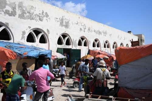 market, customers, sellers, merchants, commerce, men, women, building, people, trade, business center