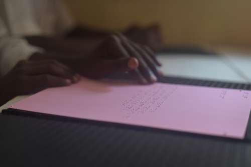 paper, education, document, office, desk, school, writing, blur, book bindings, table, information, hands, blind, disabled, learning, reading, school