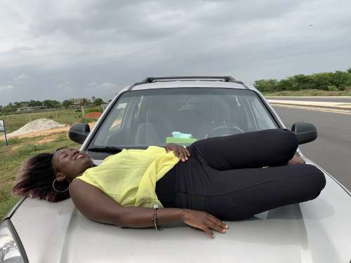 car, woman, lying, people, facial expression, parked, tired, rest, break, pose, posture, model, road trip