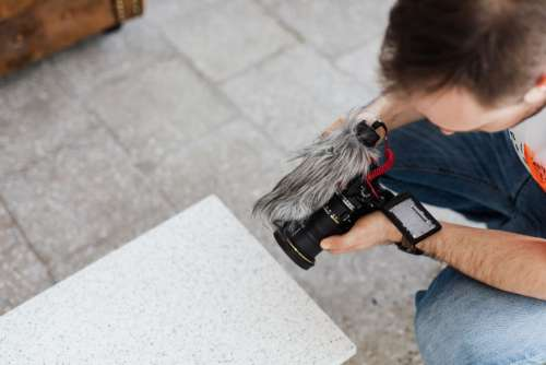 Filmmaker with DSLR Camera Taking Shoots