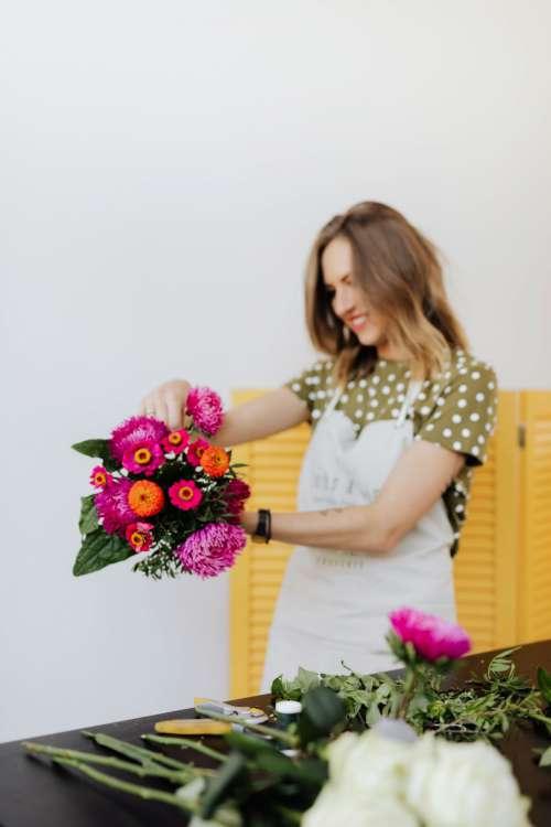 A beautiful woman florist makes a bouquet