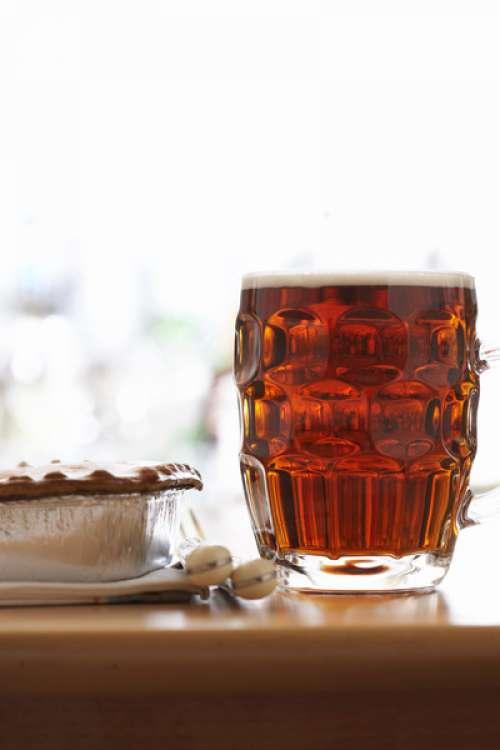 Pint of beer by pie