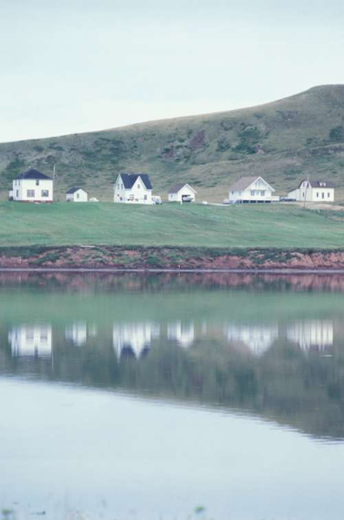 Row of houses reflected in lake