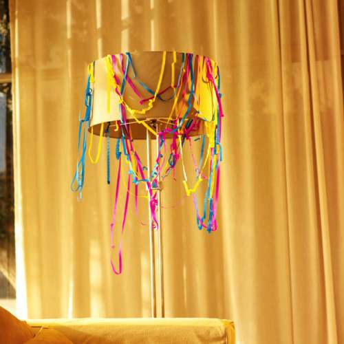 a lamp covered in streamers