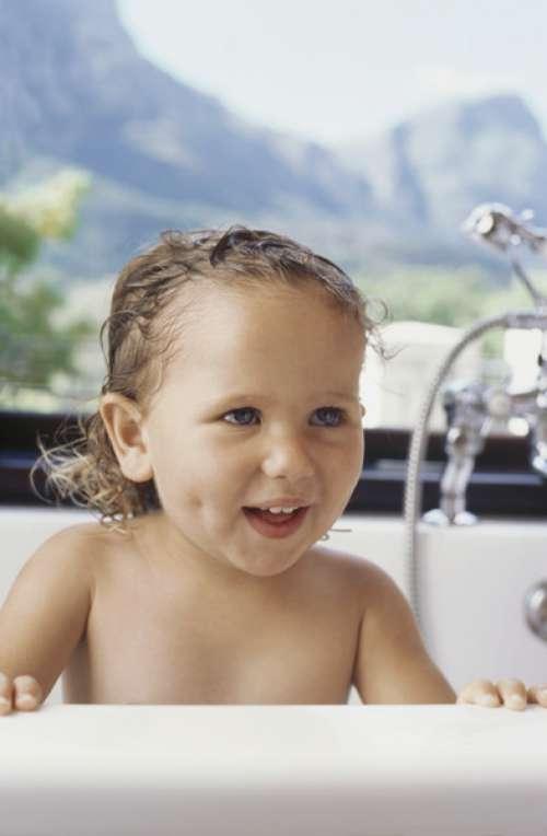Close-up of a baby boy in a bathtub