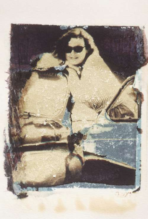 Effected image of woman by car