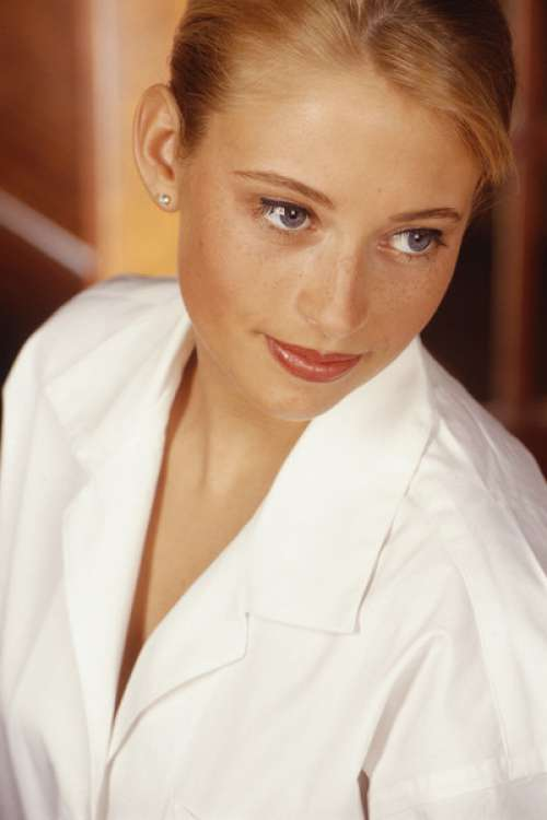 Young woman wearing white blouse, indoors