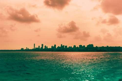 city sunset sky water warm