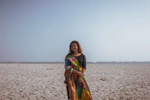 Woman In Sari On Beach Photo