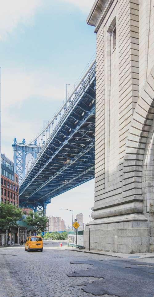 New York Taxi Under Brooklyn Bridge Photo