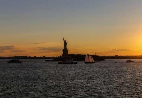 Statue Of Liberty Lit By Sunset Photo