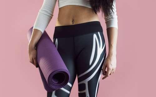 Female Yoga Fashion with Yoga Mat Photo