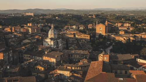 Sunsetting Over Town With Terracotta Roofs Photo