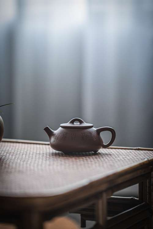 Clay Teapot On The Table Photo