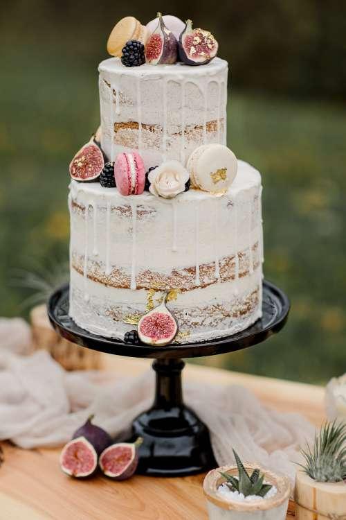White Cake On Black Cake Stand Photo