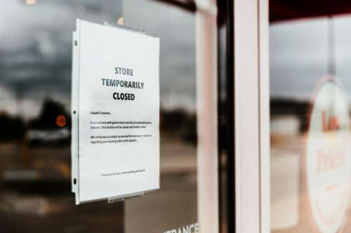 Temporarily Closed Sign On Store Front Photo