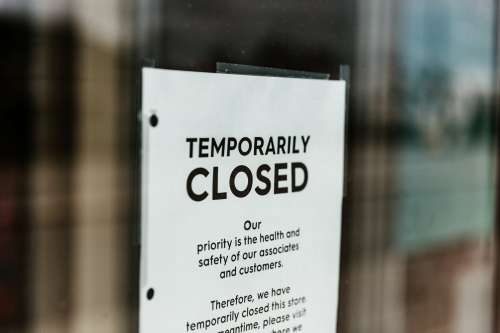 Temporarily Closed Sign On Door Photo