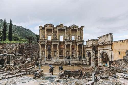 Tourists Wander Around Ruins Photo