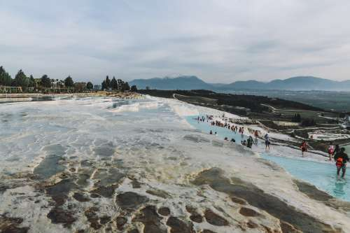Layered Thermal Pools With Tourists Photo
