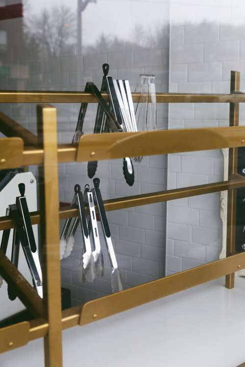 Food Tongs On A Gold Rack Photo