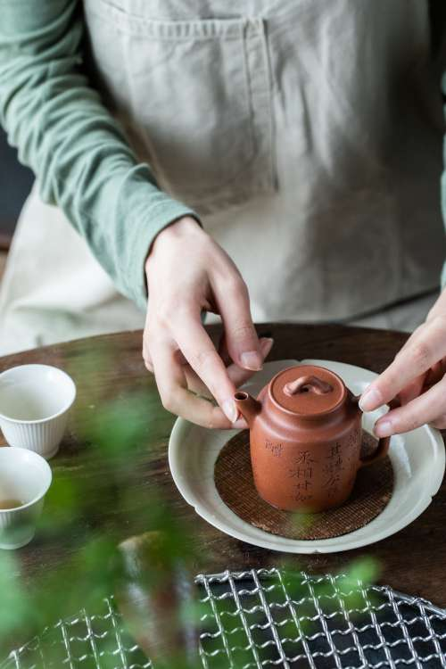 Teapot In A Womans Hands Photo
