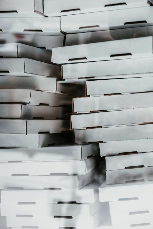 A Bunch Of Cardboard Pizza Boxes Photo