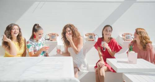 Women Sipping Cocktails In A White Room Photo