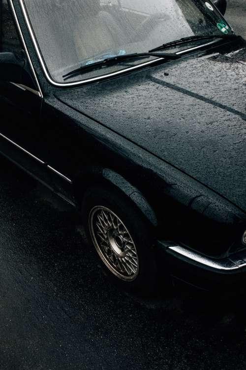 Rain-covered Vintage Car Photo
