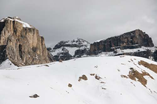 Rocky Mountenous Landscape Surrounded By Snow Photo