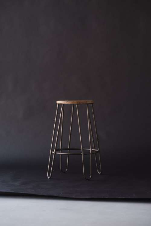 A Lonely Stool On a Backdrop Photo