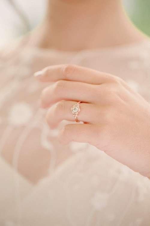 Bride Holds Up Wedding Ring Photo