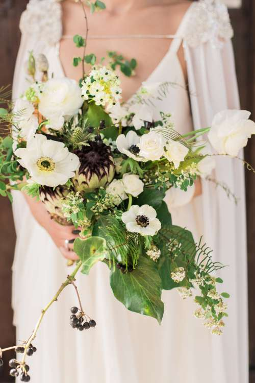 A Bride Holds Her Bouquet Photo